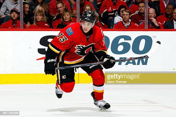 Johnny Gaudreau of the Calgary Flames skates against the Vancouver Canucks at Scotiabank Saddledome during the NHL season opener on October 7 2015 in...