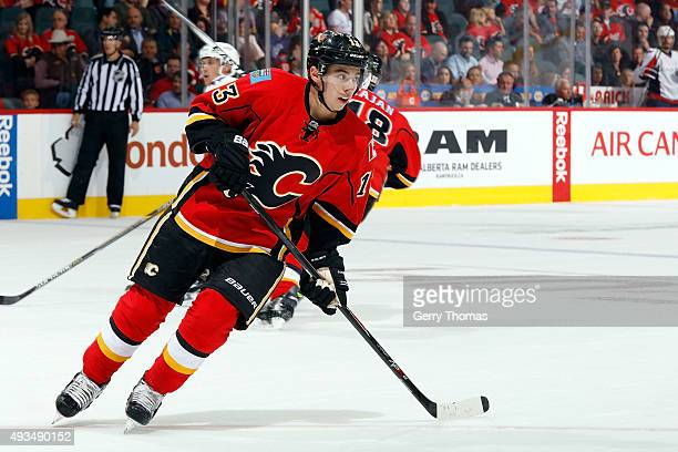 Johnny Gaudreau of the Calgary Flames skates against the Washington Capitals during an NHL game at Scotiabank Saddledome on October 20 2015 in...