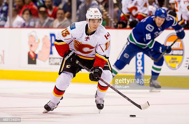 Johnny Gaudreau of the Calgary Flames skates with the puck in NHL action against the Vancouver Canucks on October 10 2015 at Rogers Arena in...