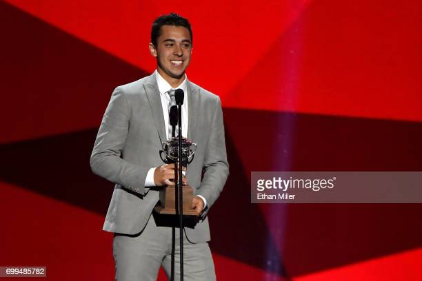 Johnny Gaudreau of the Calgary Flames speaks after winning the Lady Byng Memorial Trophy awarded 'to the player adjudged to have exhibited the best...