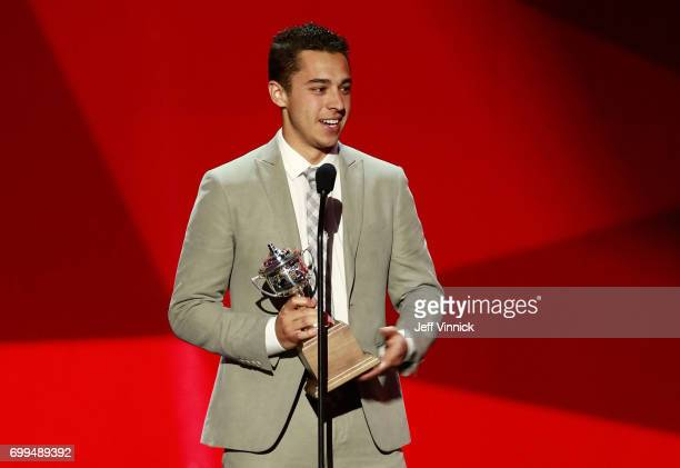 Johnny Gaudreau of the Calgary Flames speaks onstage after being awarded the Lady Byng Memorial Trophy during the 2017 NHL Awards Expansion Draft at...