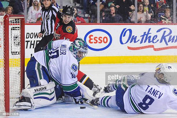 Johnny Gaudreau of the Calgary Flames takes a shot on Ryan Miller of the Vancouver Canucks during an NHL game at Scotiabank Saddledome on February 14...