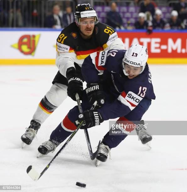 Johnny Gaudreau of USA is challenged by Moritz Mueller of Germany during the 2017 IIHF Ice Hockey World Championship game between USA and Germany at...