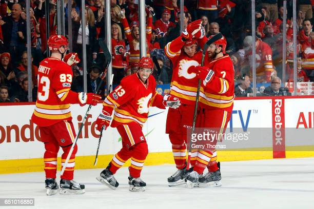 Johnny Gaudreau Sam Bennett and teammates of the Calgary Flames celebrate a goal against the Montreal Canadiens during an NHL game on March 9 2017 at...