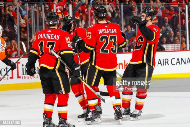 Johnny Gaudreau Travis Hamonic Sean Monahan and TJ Brodie of the Calgary Flames in a game against the Philadelphia Flyers at the Scotiabank...