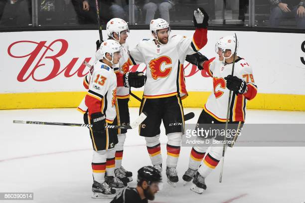 Johnny Gaudreau Travis Hamonic TJ Brodie and Micheal Ferland of the Calgary Flames celebrate a goal against the Los Angeles Kings at STAPLES Center...