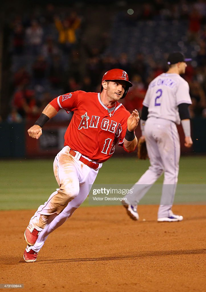 Johnny Giavotella #12 of the Los Angeles Angels of Anaheim rounds second base en route to scoring on a double to right center by teammate Matt Joyce #20 (not in photo) in the eighth inning during the MLB game against the Colorado Rockies at Angel Stadium of Anaheim on May 12, 2015 in Anaheim, California. The Angels defeated the Rockies 5-2.