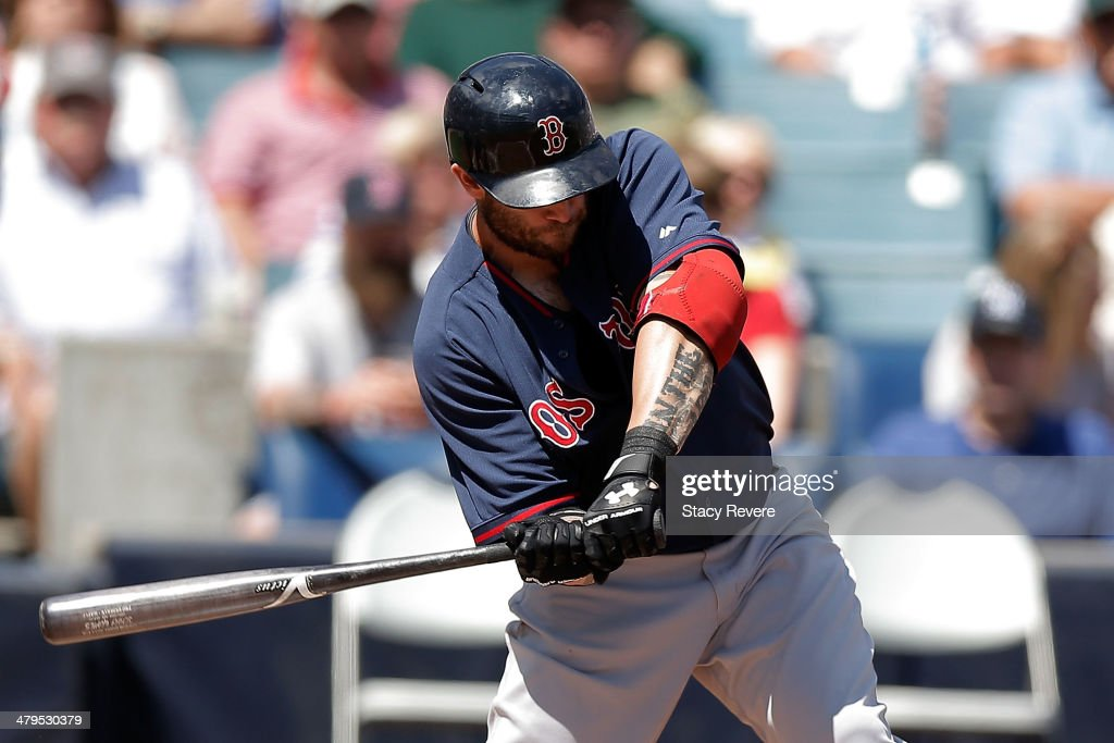 Johnny Gomes #5 of the Boston Red Sox swings at a pitch in the first inning of a game against the New York Yankees at George M. Steinbrenner Field on March 18, 2014 in Tampa, Florida.