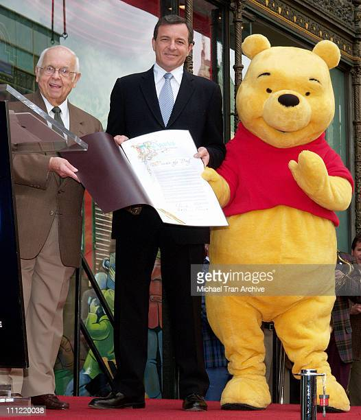 Johnny Grant Robert Iger CEO of The Walt Disney Company and Winnie The Pooh