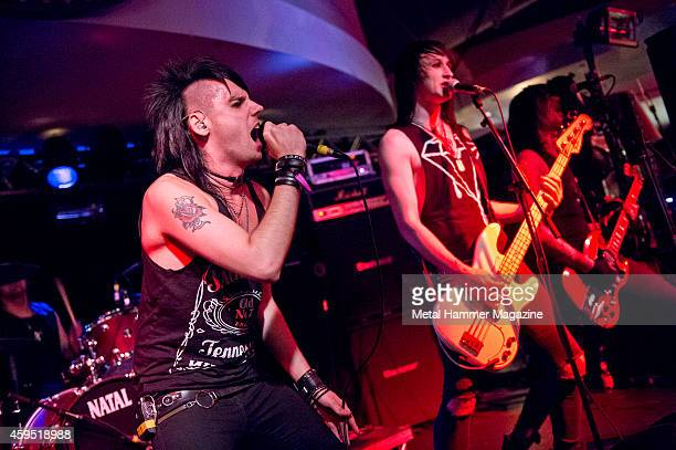 Johnny Gunn Hex Panic and Dagan Wilkin of British glam metal group The Treatment performing live on stage at the 2013 Hard glam metal Hell festival...