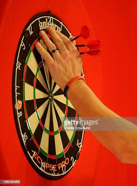 Johnny Haines of England collects his darts during his first round match against Wes Newton of England on day five of the Ladbrokescom World Darts...