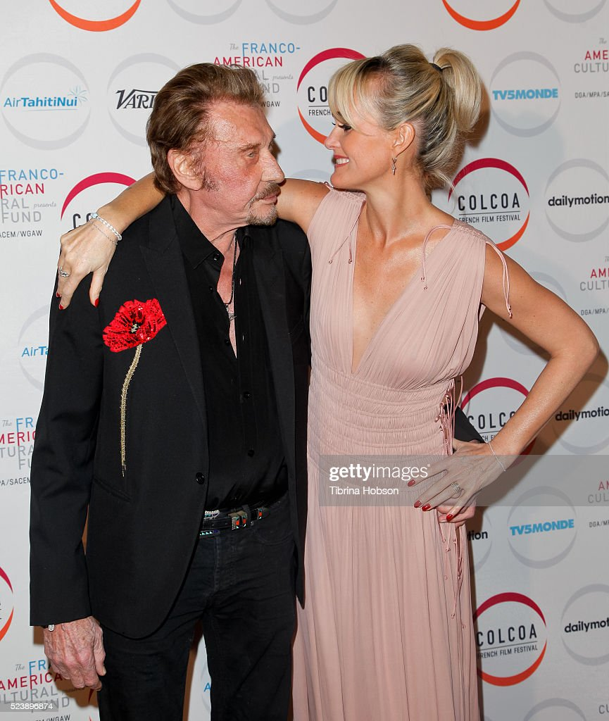 Johnny Hallyday and his wife Laeticia Hallyday attend opening night of the 20th annual COLCOA French Film Festival at Directors Guild of America on April 18, 2016 in Los Angeles, California.