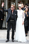 Johnny Hallyday and Laeticia Hallyday arrive at the Christian Dior Haute Couture Fall/Winter 20162017 show as part of Paris Fashion Week on July 4...