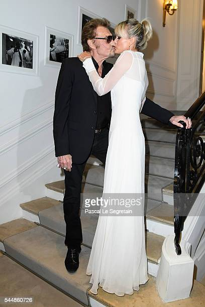 Johnny Hallyday and Laeticia Hallyday attend the Christian Dior Haute Couture Fall/Winter 20162017 show as part of Paris Fashion Week at 30 Avenue...