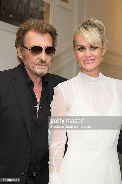 Johnny Hallyday and Laeticia Hallyday attend the Christian Dior Haute Couture Fall/Winter 20162017 show as part of Paris Fashion Week on July 4 2016...