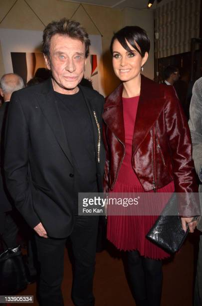 Johnny Hallyday and Laeticia Hallyday attend the Christian Louboutin 20th Anniversary Book Launch at Christian Louboutin Galerie VeroDodat at...