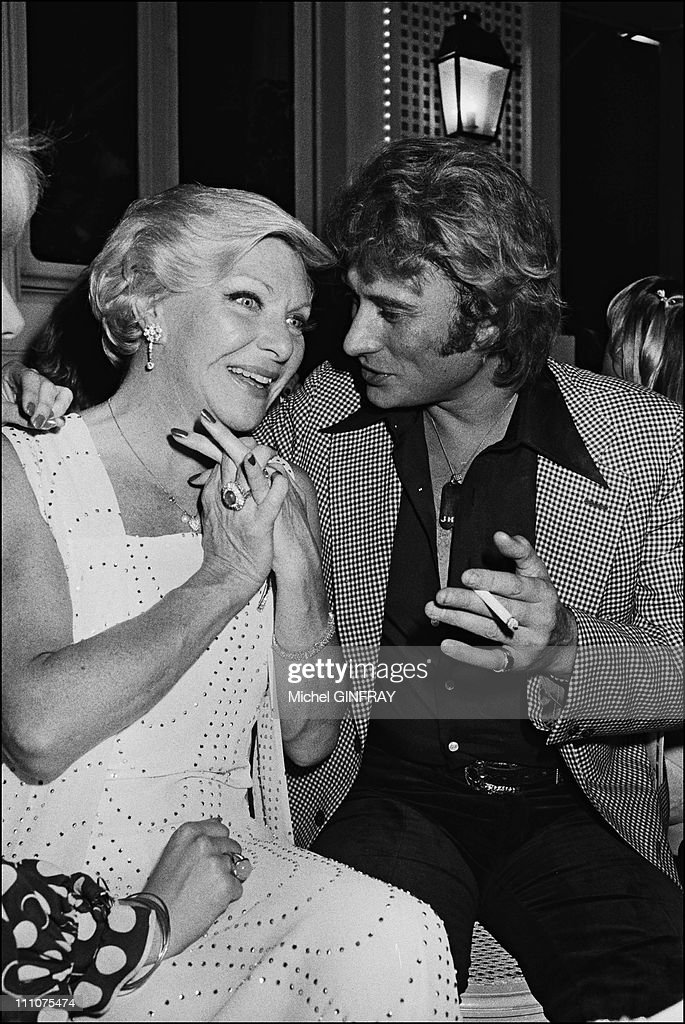 <a gi-track='captionPersonalityLinkClicked' href=/galleries/search?phrase=Johnny+Hallyday&family=editorial&specificpeople=243155 ng-click='$event.stopPropagation()'>Johnny Hallyday</a> and <a gi-track='captionPersonalityLinkClicked' href=/galleries/search?phrase=Line+Renaud&family=editorial&specificpeople=220398 ng-click='$event.stopPropagation()'>Line Renaud</a> at the 34th birthday of <a gi-track='captionPersonalityLinkClicked' href=/galleries/search?phrase=Johnny+Hallyday&family=editorial&specificpeople=243155 ng-click='$event.stopPropagation()'>Johnny Hallyday</a> in France on June 15th, 1977.