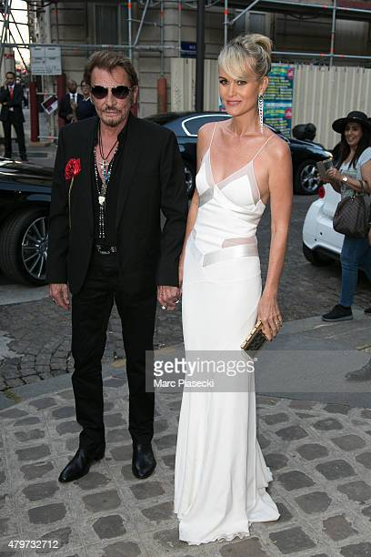 Johnny Hallyday and wife Laeticia hallyday attend the 'VOGUE' party on July 6 2015 in Paris France