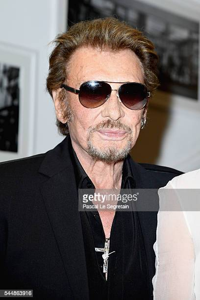Johnny Hallyday attends the Christian Dior Haute Couture Fall/Winter 20162017 show as part of Paris Fashion Week at 30 Avenue Montaigne on July 4...