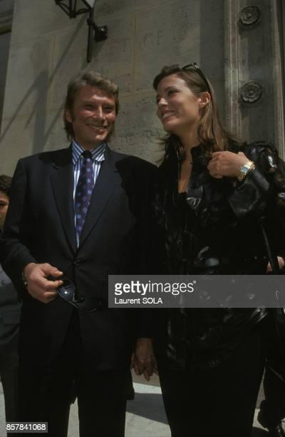 Johnny Hallyday et Karine au mariage de PaulLoup Sulitzer et Delphine Jacobson le 24 juin 1993 a Paris France