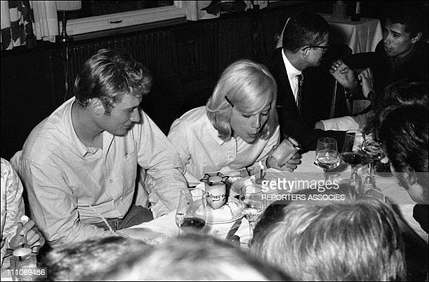 Johnny Hallyday in the sixties in France Johnny and Sylvie in a restaurant in France on August 09 1965