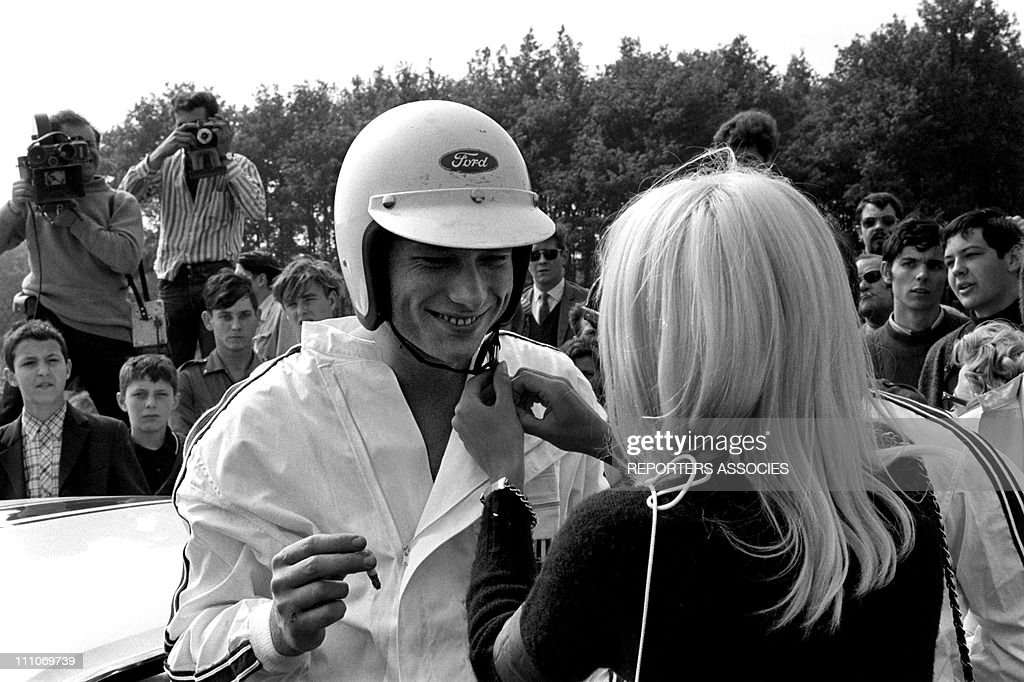 <a gi-track='captionPersonalityLinkClicked' href=/galleries/search?phrase=Johnny+Hallyday&family=editorial&specificpeople=243155 ng-click='$event.stopPropagation()'>Johnny Hallyday</a> in the sixties in France - <a gi-track='captionPersonalityLinkClicked' href=/galleries/search?phrase=Johnny+Hallyday&family=editorial&specificpeople=243155 ng-click='$event.stopPropagation()'>Johnny Hallyday</a> and <a gi-track='captionPersonalityLinkClicked' href=/galleries/search?phrase=Sylvie+Vartan&family=editorial&specificpeople=235775 ng-click='$event.stopPropagation()'>Sylvie Vartan</a> at the Montlhery circuit in France on June 18, 1967.