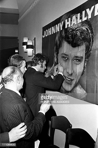 Johnny Hallyday in the sixties in France Johnny Hallyday is in Apville signing autographs in France on August 12 1966