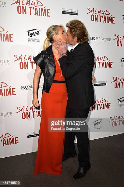 Johnny Hallyday kisses his wife Læticia Hallyday during 'Salaud On T'Aime' Paris Premiere at Cinema UGC Normandie on March 31 2014 in Paris France