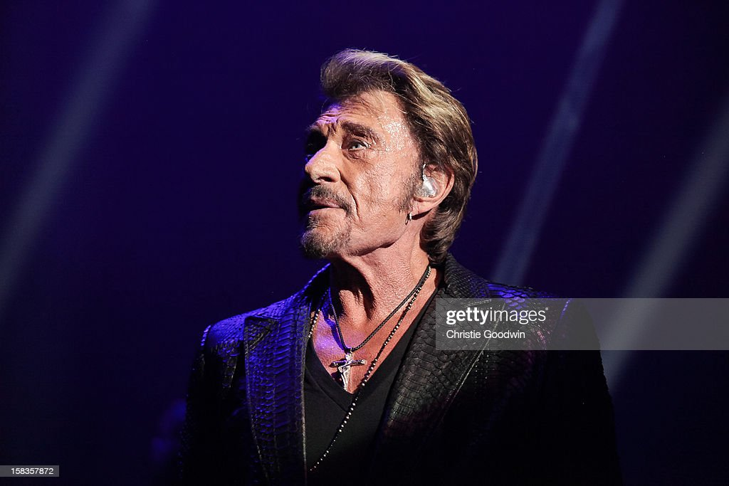<a gi-track='captionPersonalityLinkClicked' href=/galleries/search?phrase=Johnny+Hallyday&family=editorial&specificpeople=243155 ng-click='$event.stopPropagation()'>Johnny Hallyday</a> performs on stage at the Royal Albert Hall on October 16, 2012 in London, United Kingdom.