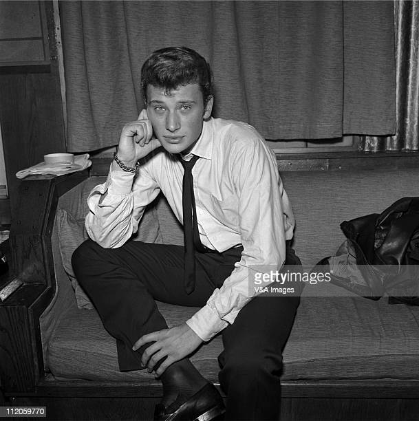 Johnny Hallyday posed backstage 1960