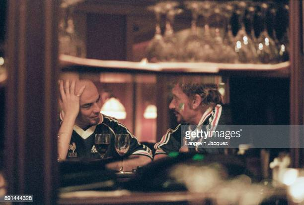 Johnny Hallyday with french singer and songwriter Pascal Obispo after the win of France for 1998 Football worldcup 12th July 1998