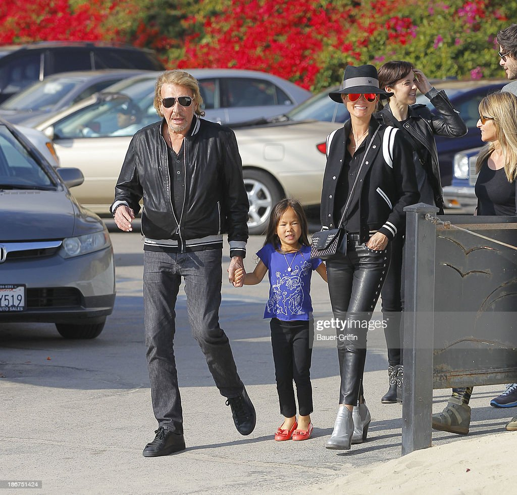 <a gi-track='captionPersonalityLinkClicked' href=/galleries/search?phrase=Johnny+Hallyday&family=editorial&specificpeople=243155 ng-click='$event.stopPropagation()'>Johnny Hallyday</a> with wife, <a gi-track='captionPersonalityLinkClicked' href=/galleries/search?phrase=Laeticia+Hallyday&family=editorial&specificpeople=3100080 ng-click='$event.stopPropagation()'>Laeticia Hallyday</a> (R) and daughter, Joy Hallyday (C) are seen in on November 03, 2013 in Los Angeles, California.