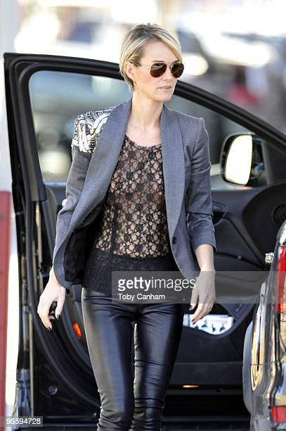 Johnny Hallyday's wife Laetitia is seen as the couple test drives a Mercedes sport utility vehicle on January 5 2010 in Los Angeles California