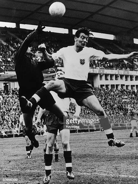Johnny Haynes the England insideleft in a tussle with Russian goalkeeper Iachine during a World Cup playoff match at Gothenburg 19th June 1958...