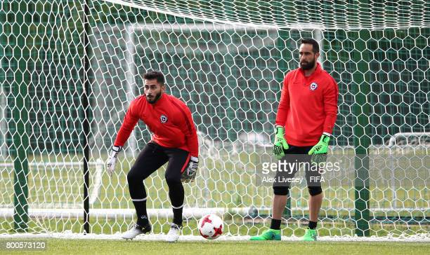 Johnny Herrera and Claudio Bravo of Chile look on during a training session at the Strogino Training Ground during the FIFA Confederations Cup Russia...