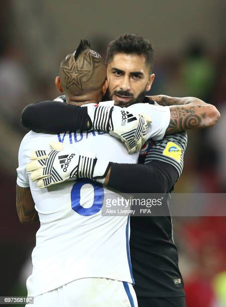 Johnny Herrera of Chile and Arturo Vidal of Chile embrace after the FIFA Confederations Cup Russia 2017 Group B match between Cameroon and Chile at...