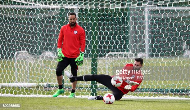 Johnny Herrera of Chile makes a save while Claudio Bravo looks on during a training session at the Strogino Training Ground during the FIFA...