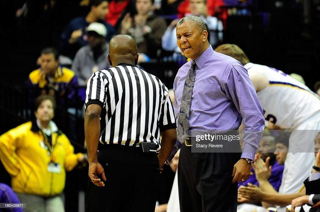 Johnny Jones, head coach of the LSU Tigers, discusses a call with an official during a game against the Missouri Tigers at the Pete Maravich Assembly Center on January 30, 2013 in Baton Rouge, Louisiana. LSU won the game 73-70.