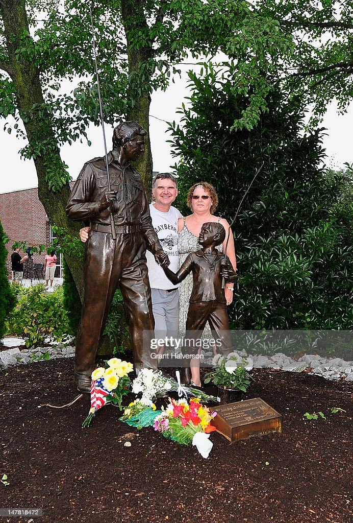 Johnny Killiam and his wife Ann Huffman pose for a photo next to a statue of actor Andy Griffith on July 3, 2012 in Mt Airy, North Carolina. Griffith died around 7am at his North Carolina home at age 86.