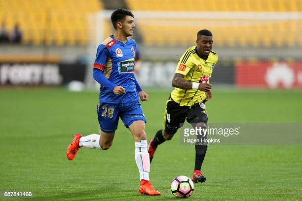 Johnny Koutroumbis of the Jets beats the defense of Roly Bonevacia of the Phoenix during the round 24 ALeague match between Wellington Phoenix and...