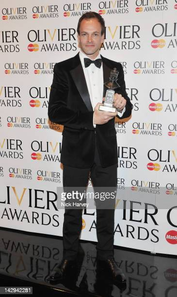 Johnny Lee Miller winner of Best Actor poses in the Olivier Awards 2012 press room at The Royal Opera House on April 15 2012 in London England