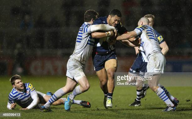 Johnny Leota of Sale is tackled by Ducan Taylor and Charlie Hodgson of Saracens during the Aviva Premiership match between Sale Sharks and Saracens...