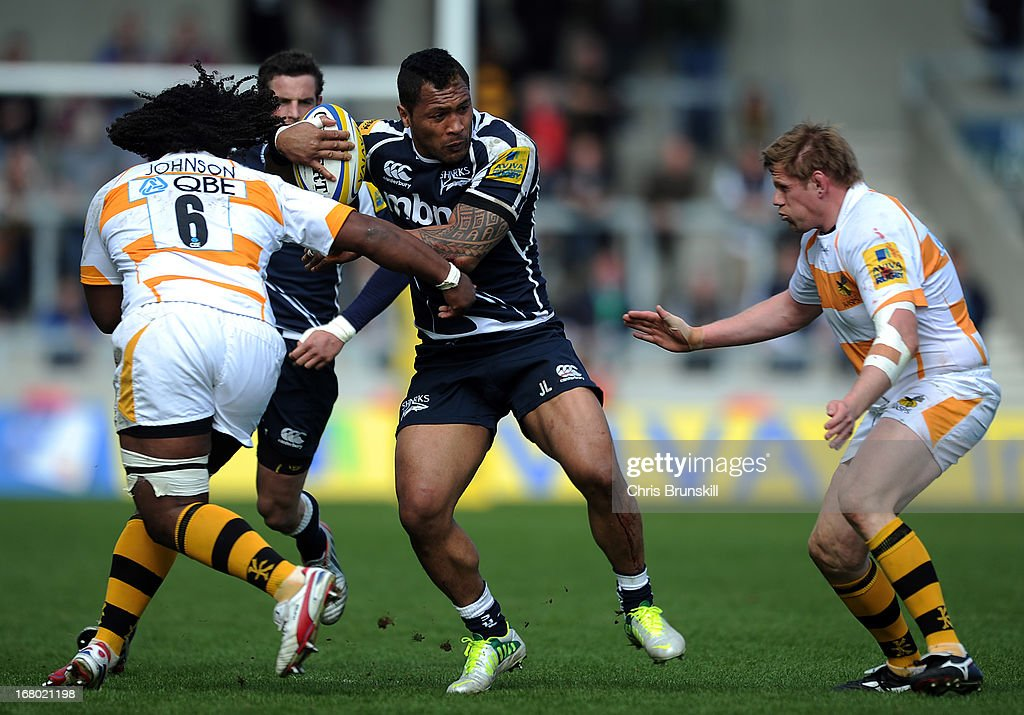 Johnny Leota of Sale Sharks is tackled by <a gi-track='captionPersonalityLinkClicked' href=/galleries/search?phrase=Ashley+Johnson+-+Rugby+Union+Player&family=editorial&specificpeople=15285872 ng-click='$event.stopPropagation()'>Ashley Johnson</a> of London Wasps during the Aviva Premiership match between Sale Sharks and London Wasps at the Salford City Stadium on May 04, 2013 in Salford, England.