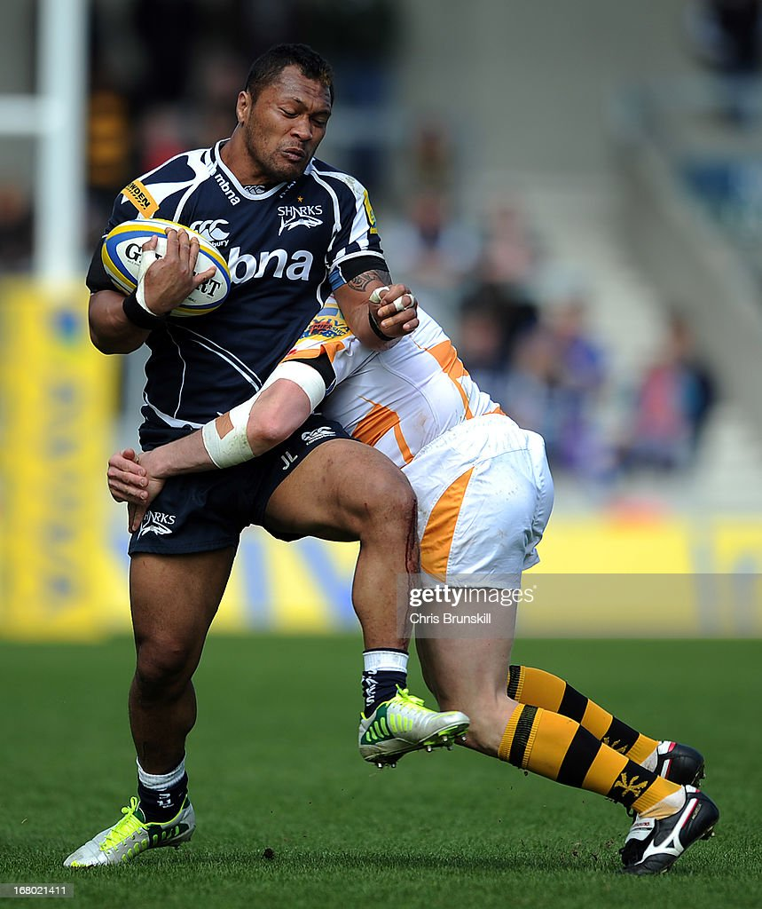 Johnny Leota of Sale Sharks is tackled by Lorenzo Romano of London Wasps during the Aviva Premiership match between Sale Sharks and London Wasps at the Salford City Stadium on May 04, 2013 in Salford, England.