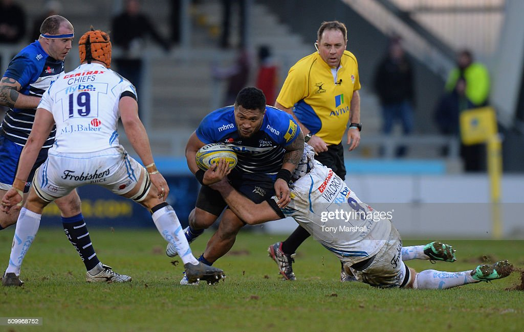 Johnny Leota of Sale Sharks is tackled by <a gi-track='captionPersonalityLinkClicked' href=/galleries/search?phrase=Thomas+Waldrom&family=editorial&specificpeople=561813 ng-click='$event.stopPropagation()'>Thomas Waldrom</a> of Exeter Chiefs during the Aviva Premiership match between Sale Sharks and Exeter Chiefs at the A J Bell Stadium on February 13, 2016 in Salford, England
