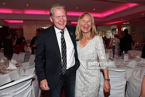 Johnny Logan and Sybille Beckenbauer laugh after his 'kiss on his own hand' during the Franz Roth Golf Cup gala evening in favour of Michael Roll...