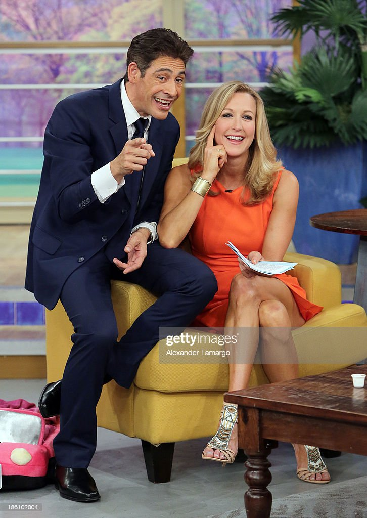 Johnny Lozada and Lara Spencer are seen on the set of Despierta America for simulcast with 'Good Morning America' and Fusion's the Morning Show' at Univision Headquarters on October 28, 2013 in Miami, Florida.