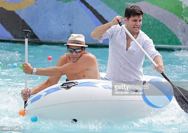 Johnny Lozada and Paul Stanley are seen on the set of Despierta America at Surfcomber Miami South Beach A Kimpton Hotel on September 12 2014 in Miami...