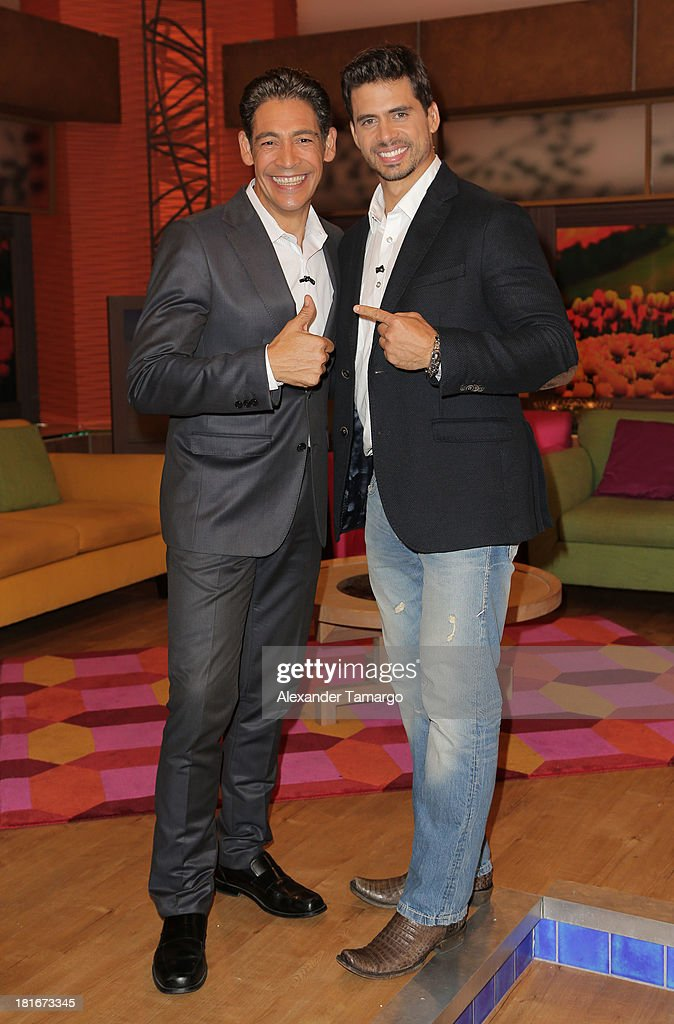<a gi-track='captionPersonalityLinkClicked' href=/galleries/search?phrase=Johnny+Lozada&family=editorial&specificpeople=7994478 ng-click='$event.stopPropagation()'>Johnny Lozada</a> and Pedro Moreno are seen on the set of Univision's 'Despierta America' morning show at Univision Headquarters on September 23, 2013 in Miami, Florida.