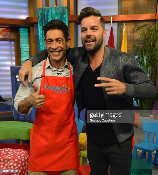 Johnny Lozada and Ricky Martin are seen on the set of Univisions 'Despierta America' on November 15 2013 in Miami United States
